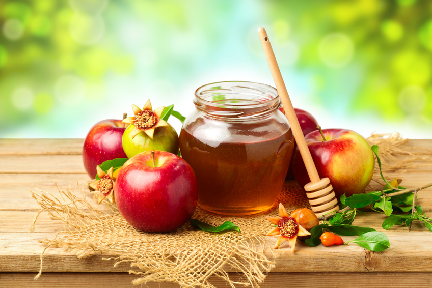 Honey, Apple And Pomegranate On Wooden Table