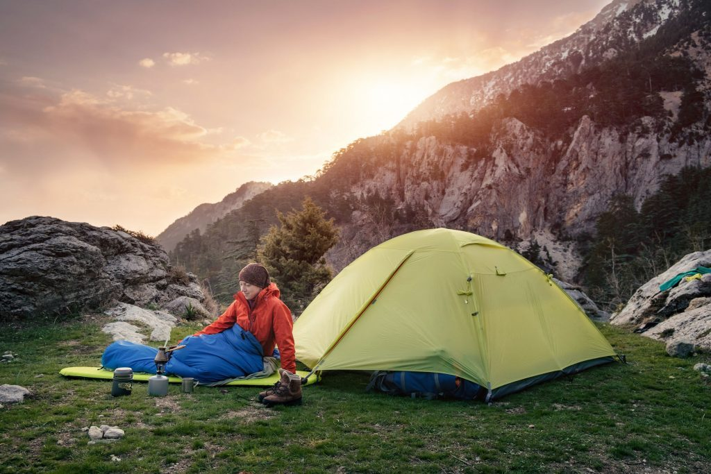 Person Outside Tent In Sleeping Bag