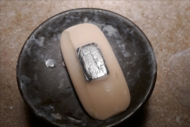 Soap With Aluminum Foil On The Back