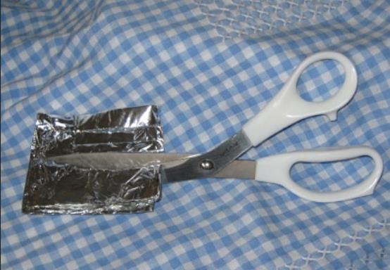 Scissors Cutting Aluminum Foil