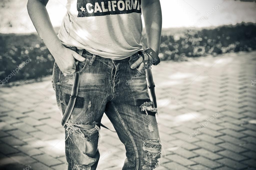 Person Wearing Patched Jeans