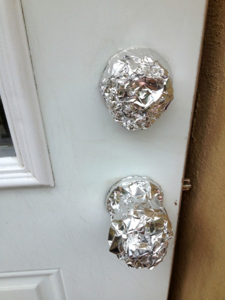 Doorknob And Deadbolt Covered In Foil